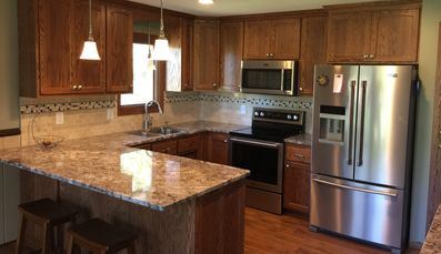 Milless Interiors custom designed kitchen remodel! Full service general contractor!