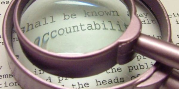 government accountability law under magnifying glass