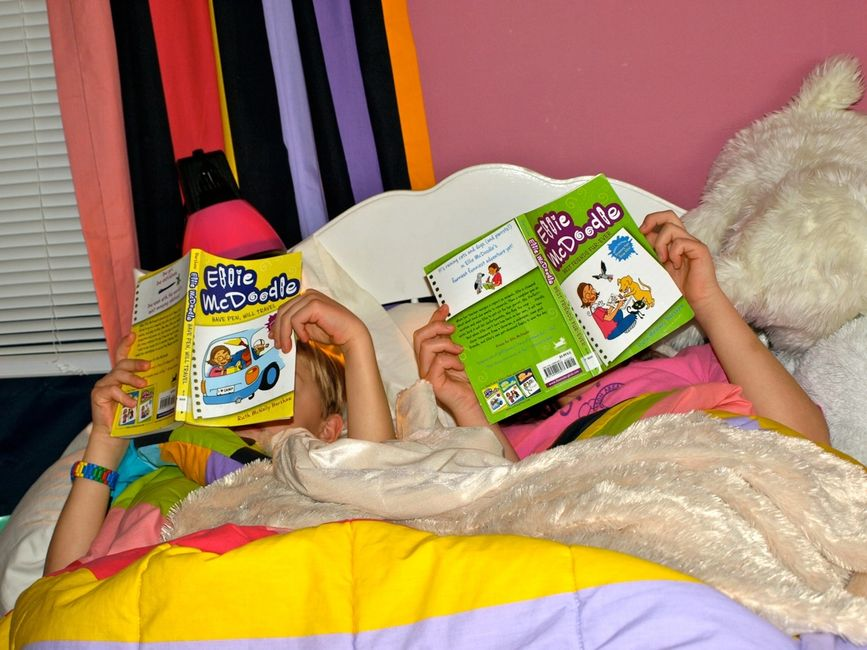 Two girls reading Ellie McDoodle books