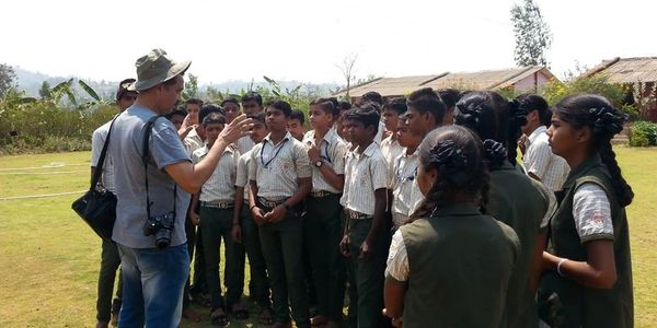 Isaac Kehimkar interacting with students of Shri Jayeshwar Vidyalaya at Dengachimet in Jawhar.