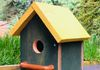 021 - Original green birdhouse with a bright yellow roof and welcoming perch.  SOLD