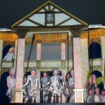 """Midsummer's Night  Dream""  replica of Shakespears's Globe theater and puppet charactures that  look"