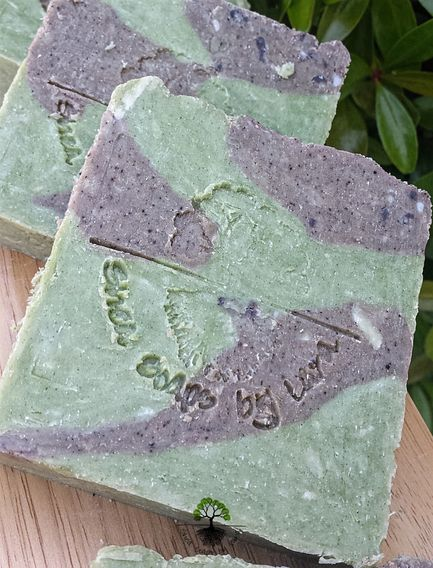 Handmade Shea Butter Soaps made with  natural colorants and scented with essential oils.