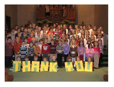 Group photograph of St. Joseph School with Thank You sign.
