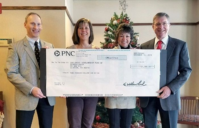PNC Bank presenting contribution check to representatives of The Children's Scholarship Fund.