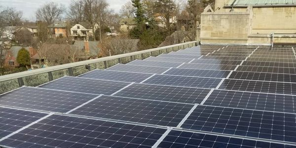 Ballasted solar array on the flat roof of St. Paul's Episcopal church in Mt. Lebanon, Pennsylvania