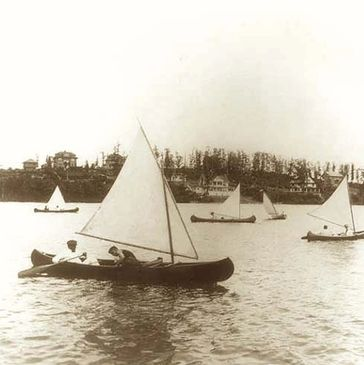 An early days image of sail canoes on the main lake.