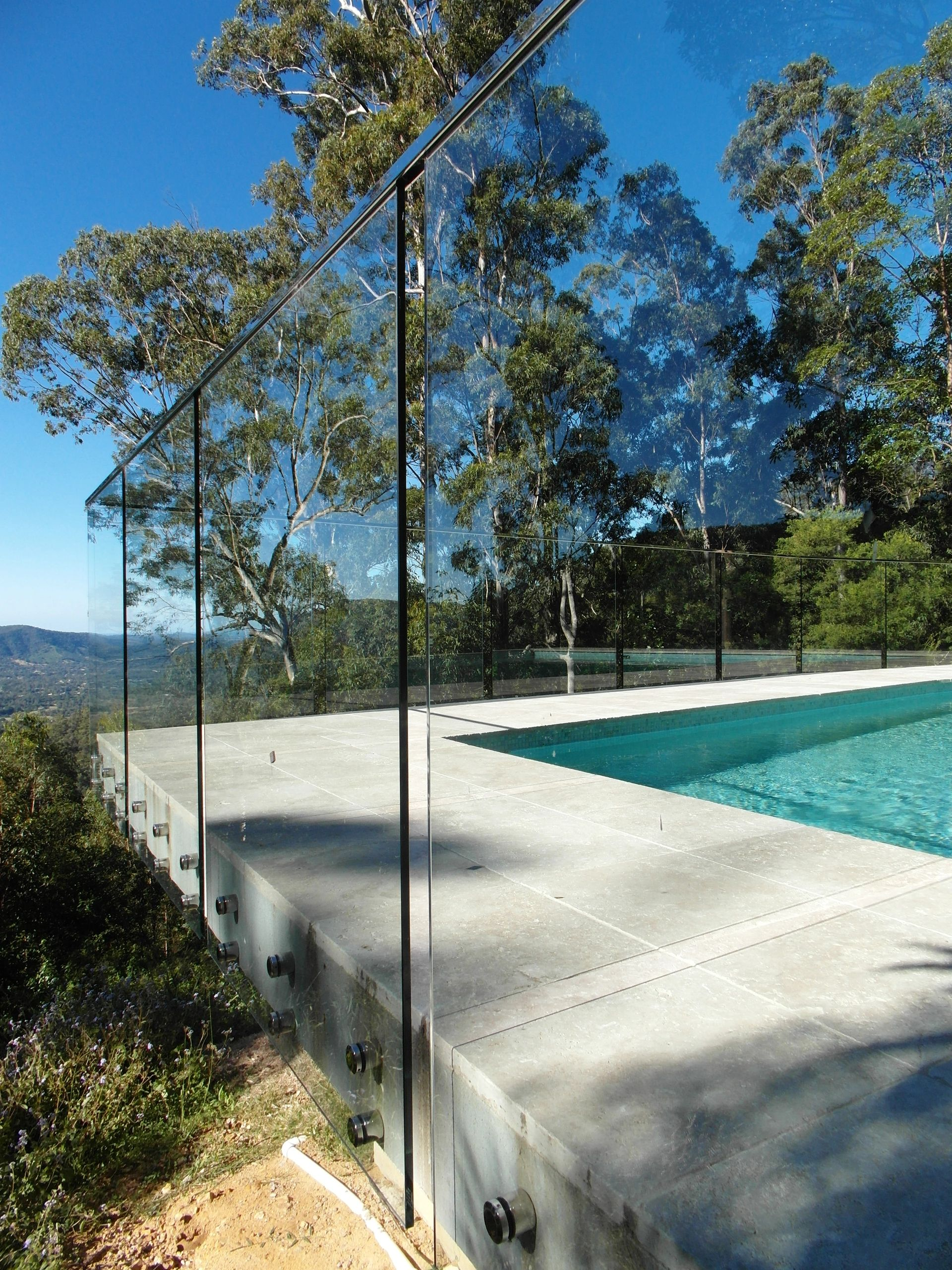 Frameless pool glass and fixings with pool