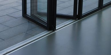 open stacked right aluminium bifold door with a level floor threshold