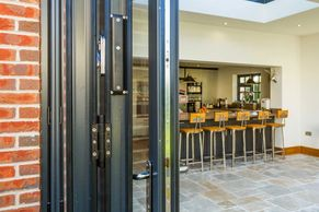 Aluminium Bi-Fold Door opened stacked to right side
