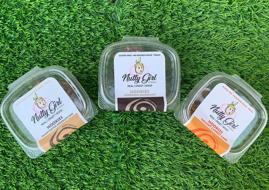 Nutty Girl by Molly is a company that makes vegan and gluten free snacks with nuts and no refined su