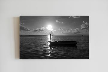 Fisherman in Mauritius. Black and white for fisherman in Mauritius. Canvas printing.