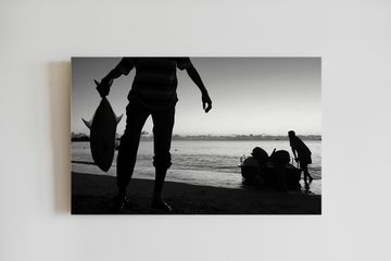 Fisherman in Mauritius. Black and white. Canvas printing. Trevally catch.