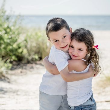 Beach Portraits of young boy and girl by Alma B Photography