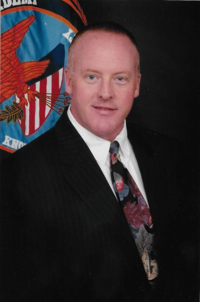 His class photo from the FBI National Academy 227th Session, October to December 2006.