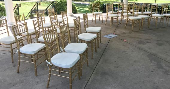 Gold Chiavari chairs with ivory cushion