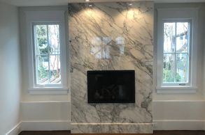"Calacutta Marble Fireplace, Miter wraps 3 walls with 7"" custom trim at bottom"