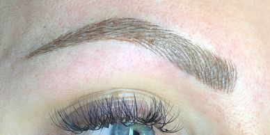 Eyebrow with microblading above eyes and eyelashes