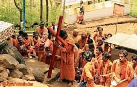 Why wearing saffron robes of Hindu monks but carrying a Cross?
