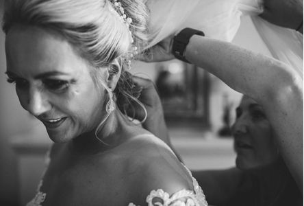 Added hair extension to create a high bun and padding use to make the bun big at Peckforton Castle