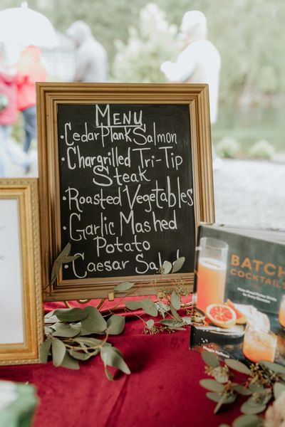 Choose your own caterer or use one of ours.  This chalkboard sign menu was made by Maverick Catering