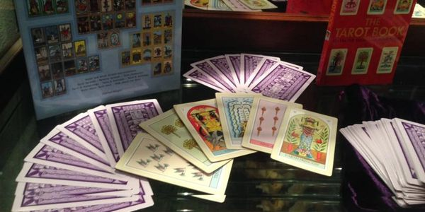 Tarot cards, oracle decks, books and cheat-sheets.