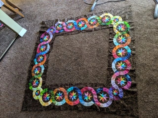 Outer border Rings Rainbow Quilt with inserted circles