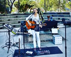 One woman loop band with acoustic guitars flutes and Brazilian percussion - conscious music