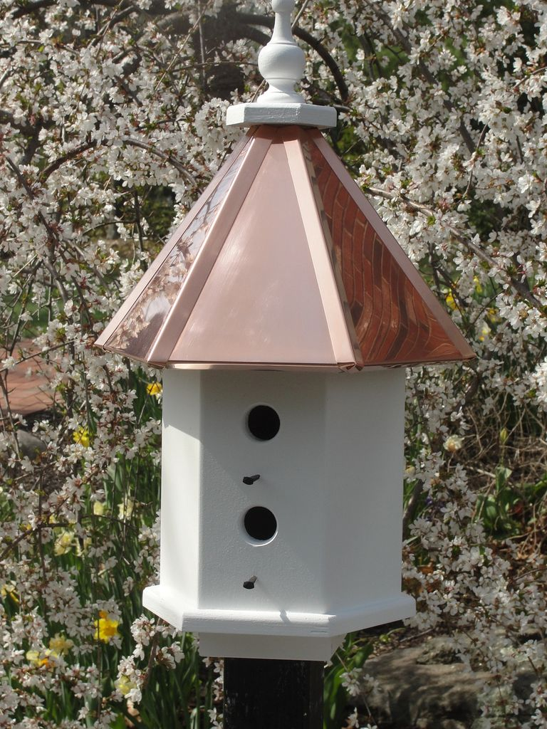 Post mounted Estate birdhouse with bright copper roof.  Four separate nesting compartments.