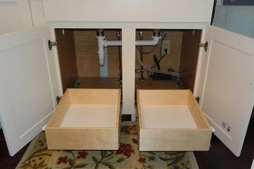 Deep slide out shelves installed under sink cabinet one deep shelf on each side of center stile