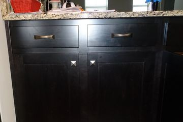 Pull out cabinet shelves inside cabinet after center stile removed and doors closed.