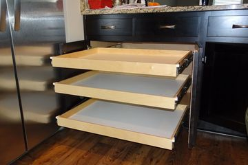 Three slide out drawers installed after center stile removed from kitchen cabinet and attached to door.