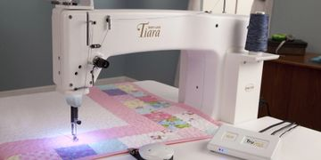 "Baby Lock Tiara 16"" long arm sit down quilter. Stitch regulation available.  Robinson Sew and Vac"
