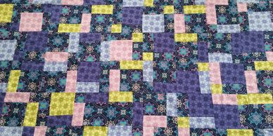 In The Fabric of Life Book 2, 12 Quilts, One of the quilts  Jana learns to make is a nine patch.