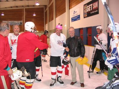 "Bob Tessier presented Dave ""Pinky"" Kates with appropriate headgear."