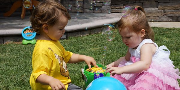 Toddlers playing with bubbles