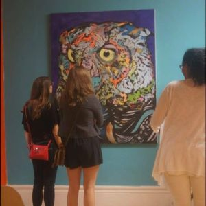 Viewing an Owl painting in a gallery in Mishawaka Indiana. Artwork by Russell Frantom