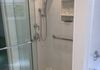 New shower stall where sink was with separate hand-held, grab bars to solid blocking, and low curb
