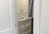 Custom walk-in closet where old shower stall and closet were