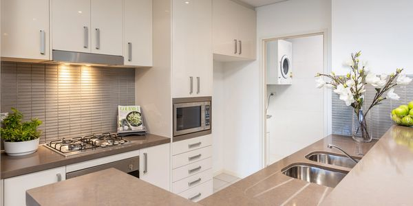 Generous galley Kitchen apartment centrally located. Water views. Shops, parks, rail, Drs at door