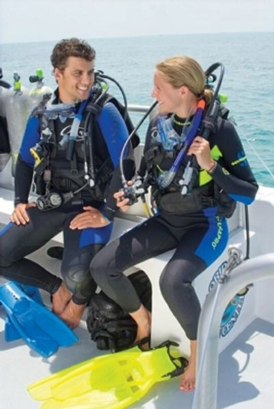 PADI Divers on a boat.