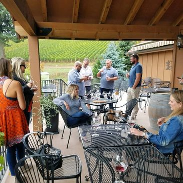 Wine tasting in Dundee Hills, guests enjoying the patio & outstanding Pinot Noir at DePonte Cellars