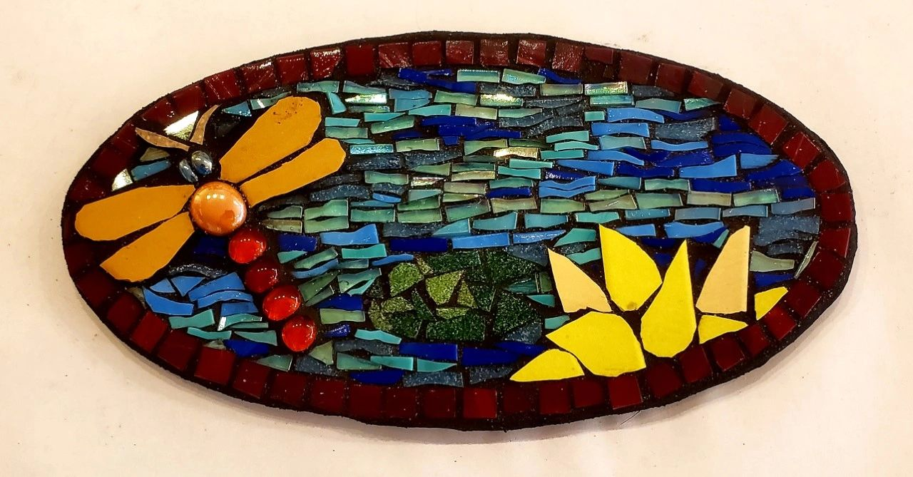 Our Dragonfly Wall Plaque is designed with porcelain and glass tiles together. in one project.