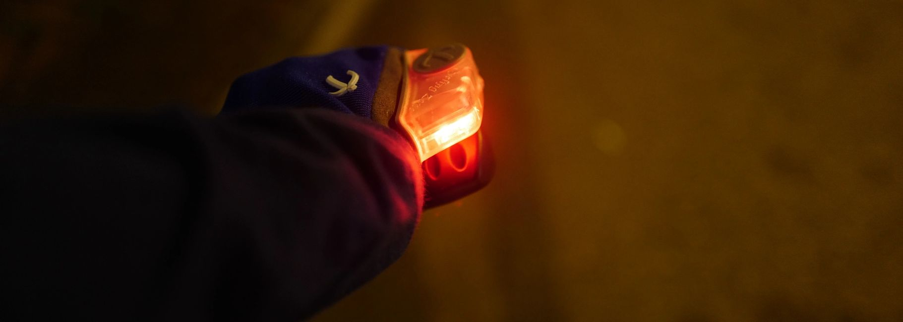 Cyclist wears BISIGNAL gloves. LED Signal light. Give signals. Turn. Brake. Bright  light. Visible