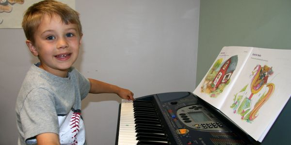 boy sitting at keyboard