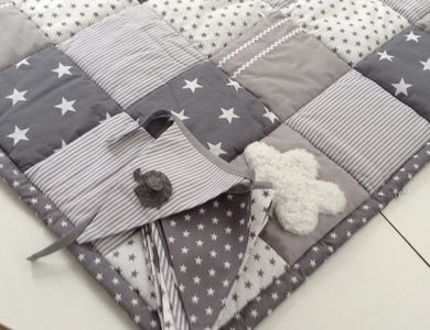 Learn how to make a patchwork quilt. Grey and white patchwork quilt and matching bunting