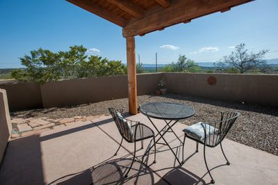 Private courtyard and covered porch w/ table & chairs.  Sit, enjoy a cup of tea or watch sunset.