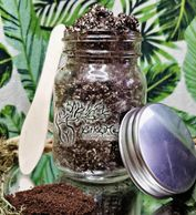 Exfoliating Coffee scrub with floral background