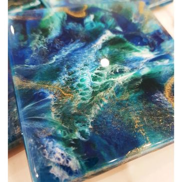 Coaster set of 4. In rich blue greens with gold sparkle.