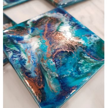 Coaster set of 4. in beautiful rich blue greens and copper.